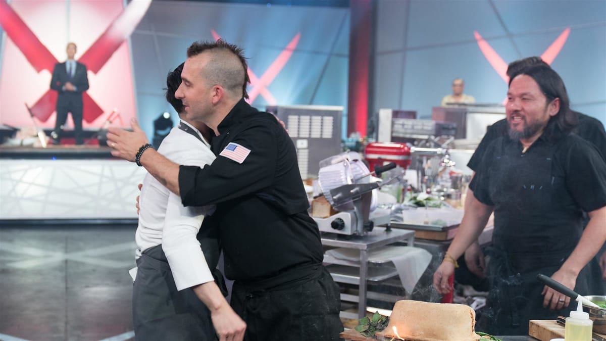 Chef Thai Dang fishes for a win against Iron Chef Marc Forgione.